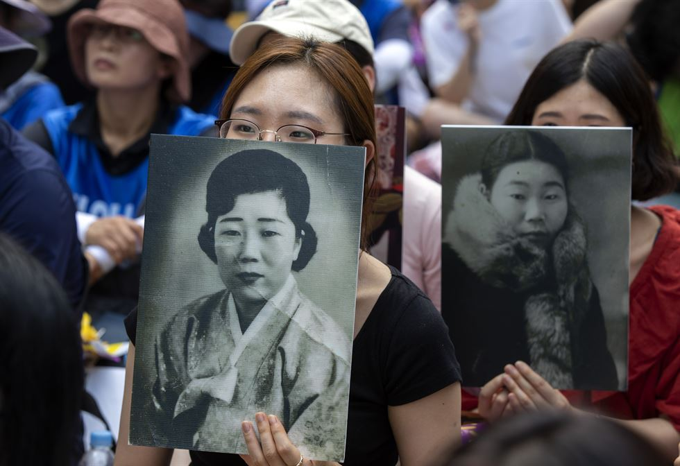 Demonstrators demand a formal apology from the Japanese government to women forced into sexual slavery for Japanese soldiers during World War II, and recognition of the victims, in front of the Japanese Embassy in Jongno-gu, Seoul, Wednesday, in their 1,348th weekly protest. The sit-in gained more traction than any other Wednesday as the day was Korean Liberation Day, which celebrates Korea's release from the 1910-45 Japanese colonial rule, following the end of the war. Korea Times photos by Shim Hyun-chul