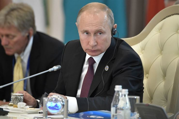 AUGUST 12, 2018: Russia's President Vladimir Putin (R) and Russian Presidential Spokesman Dmitry Peskov attend a meeting of the heads of state of the Caspian Five at the Friendship Palace. TASS-Yonhap