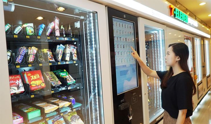 A customer at a Seven Eleven Express cashierless store in Seoul purchases a product, Monday. Courtesy of Seven Eleven