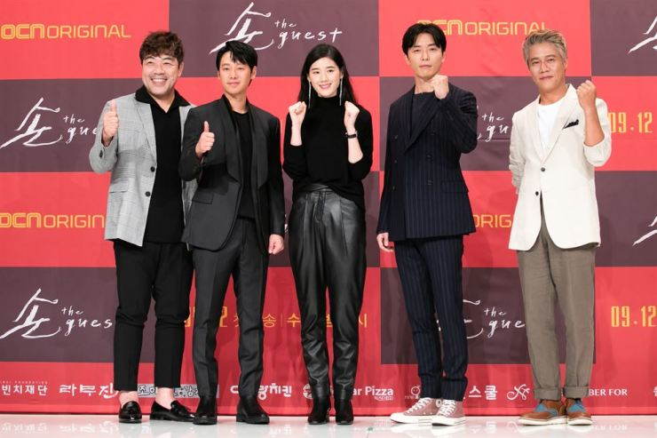Second from left, actor Kim Dong-wook, actress Jung Eun-chae and actor Kim Jae wook pose with other cast members of OCN's upcoming mystery thriller 'The Guest' during a press conference at Amoris Hall in Seoul, Thursday. / Courtesy of OCN
