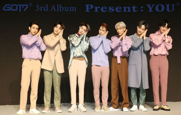 GOT7 members pose for photos during a press conference announcing the release of their new album 'Present: YOU,' Monday. Courtesy of JYP Entertainment