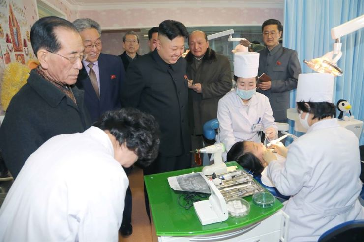 North Korean leader Kim Jong-un inspects a hospital in Pyongyang in this 2014 file photo. North Korea is stepping up its fight against TB and malaria. Yonhap