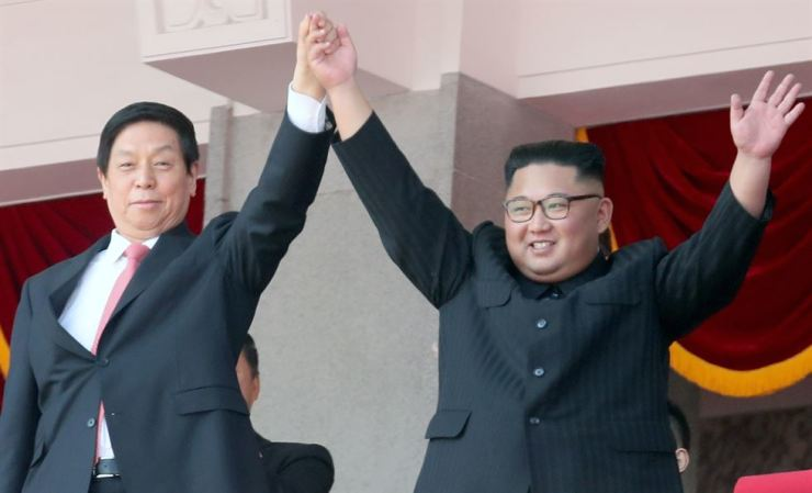 North Korean leader Kim Jong-un (R) and Li Zhanshu (L), China's third highest ranking official, wave to the crowd during a parade celebrating the North Korea's National Day and the 70th anniversary of its Foundation in Pyongyang, North Korea, 09 September 2018. TASS-Yonhap