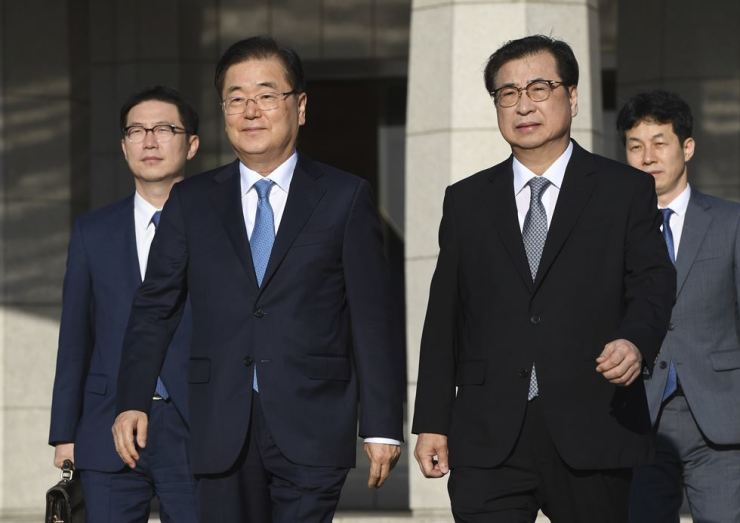 Chung Eui-yong, front left, head of the presidential National Security Office, Suh Hoon, front right, chief of the National Intelligence Service, and other South Korean delegates walk to an aircraft at a military airport in Seongnam, south of Seoul, for a flight to Pyongyang on Wednesday. AP