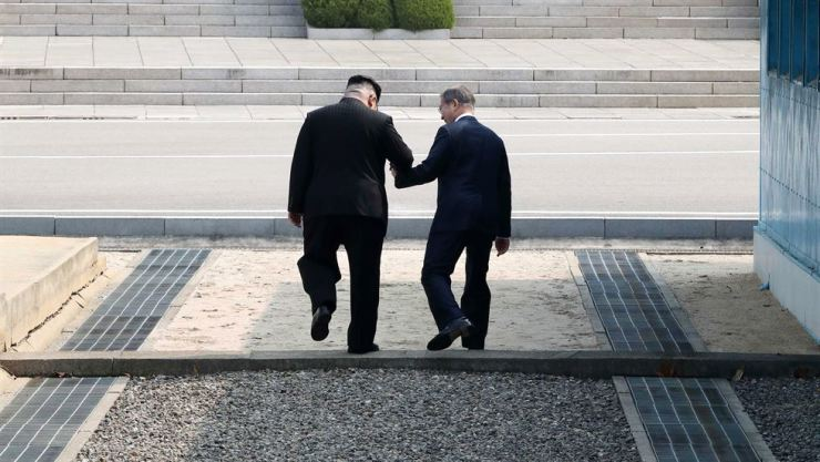 President Moon Jae-in holds hands with North Korean leader Kim Jong-un during the April 27 inter-Korean summit. Korea Times