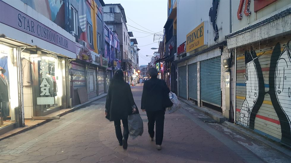 A scene from South Korean documentary film 'Host Nation' (2016). Introduced at the 22nd Seoul Human Rights Film Festival in 2017, the film portrays a Filipino woman named Maria, 26, who, dreaming of escaping her poverty-stricken slum, comes to South Korea with an E-6-2 visa, but ends up in an adult entertainment parlor near a USFK camp in a South Korean port city. Korea Times