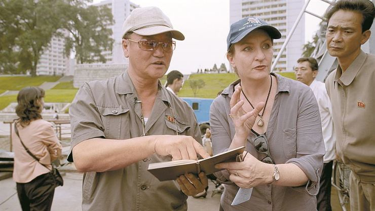 Filmmaker Anna Broinowski, center, speaks to a North Korean director in this photo taken in North Korea in September 2012. / Courtesy of DocForest