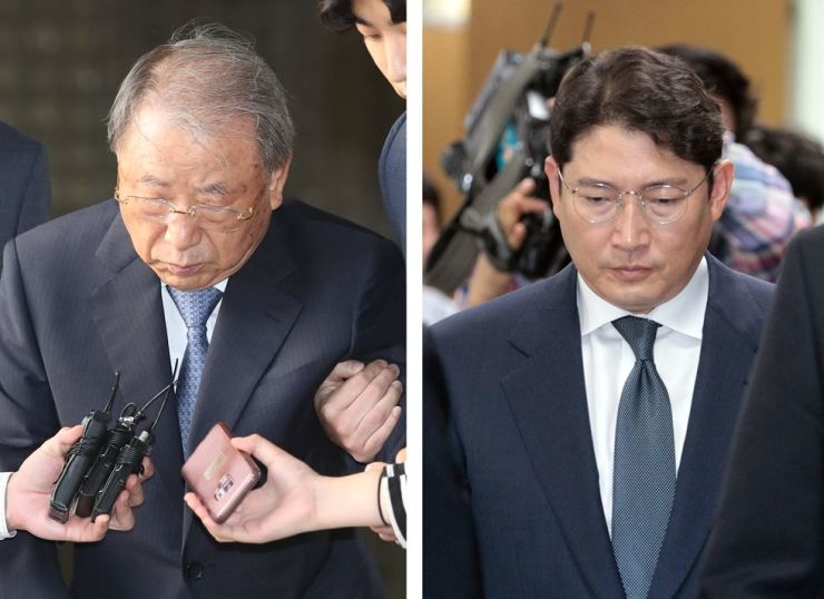 Hyosung Group Honorary Chairman Cho Seok-rae and current Chairman Cho Hyun-joon walk out of the Seoul High Court in southern Seoul, Wednesday. Yonhap