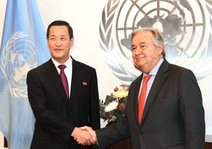 North Korea's new United Nations Ambassador Kim Song, left, shakes hands with U.N. Secretary-General Antonio Guterres at the U.N. chief's office in New York. Yonhap