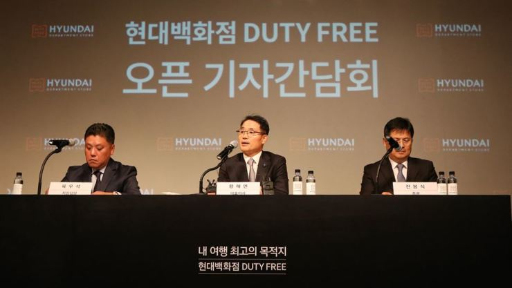 Hyundai Department Store Duty Free President Hwang Hae-yeon, center, speaks during a press conference at the company's new duty free store in southeastern Seoul, Tuesday. / Courtesy of Hyundai Department Store Group
