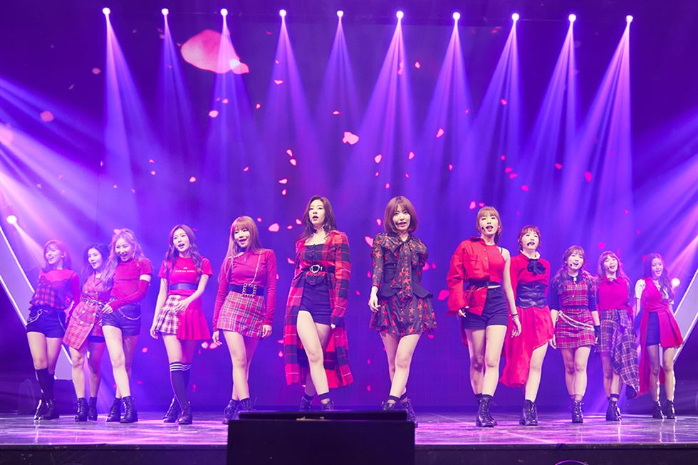 IZ*ONE members perform 'La Vie en Rose' to unveil their debut album at Olympic Hall in Seoul, Monday. Courtesy of Off The Record Entertainment