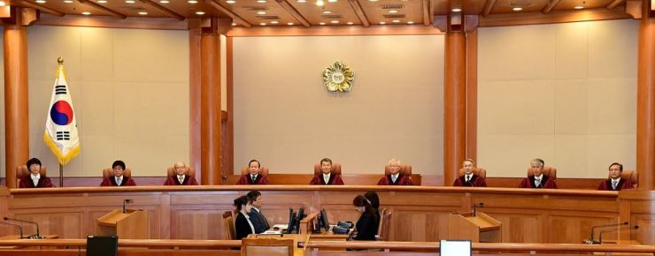 The nine-member panel of the Constitutional Court makes a ruling before five justices retired Sept. 19. / Korea Times file