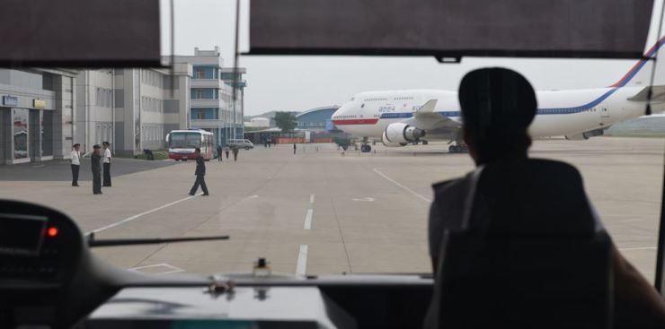 From an airport bus at Pyongyang Sunan International Airport, the South Korean presidential airplane can be seen ahead. Photos by Jon Dunbar