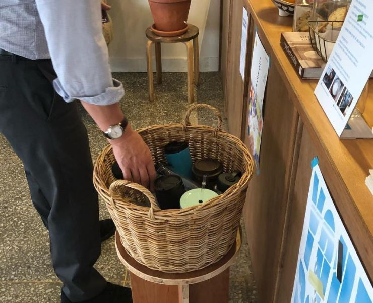 A customer borrows a tumbler next to the counter at Bottle Factory, a cafe in Mapo-gu, Seoul. / Courtesy of Bottle Factory