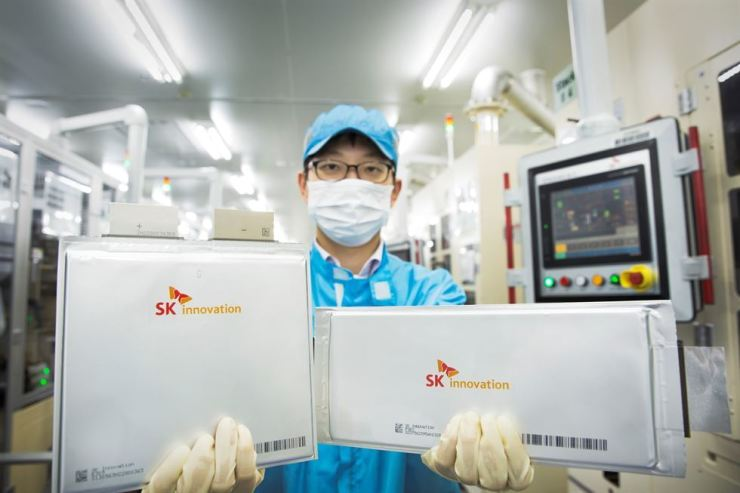 An SK Innovation researcher holds the company's electric vehicle batteries in this file photo. / Courtesy of SK Innovation