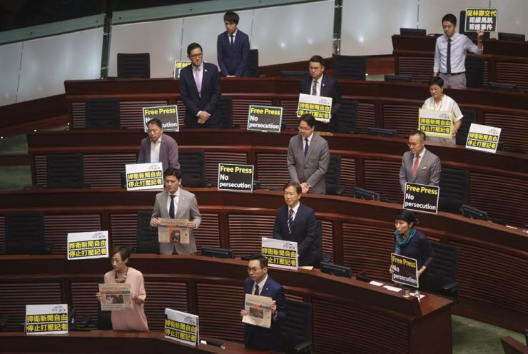 Pro-democracy lawmakers display placards 'Press freedom persecution' to protest while Hong Kong Chief Executive Carrie Lam delivering her policy speech at the Legislative Council in Hong Kong Wednesday, Oct. 10,2018. AP