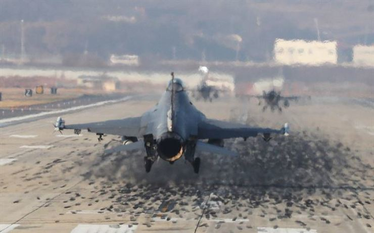 In December 2017, a F-16 fighter jet lands on the Osan Air Base of the United States Forces Korea in Pyeongtaek,p Gyeonggi Province, on the first day of Vigilant ACE. Korea Times file