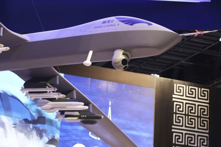 In this Sunday, Feb. 25, 2018, file photo, a model of the Wing Loong II weaponized drone hangs above the stand for the China National Aero-Technology Import & Export Corp. at a military drone conference in Abu Dhabi, United Arab Emirates. AP-Yonhap