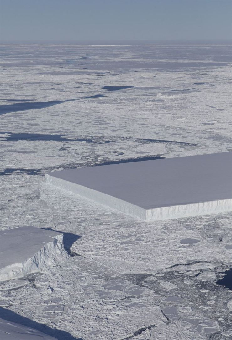 This NASA image ― obtained October 23 from an Operation IceBridge flight over Antarctica on October 16 ― shows a tabular iceberg floating among sea ice just off of the Larsen C ice shelf. The iceberg's sharp angles and flat surface indicate that it probably recently calved from the ice shelf. / AFP