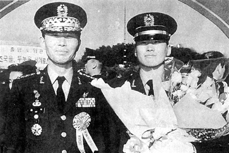 The late first lieutenant Kim Hoon, right, with his father / Korea Times