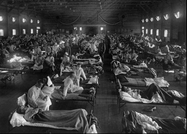 Influenza victims crowd into an emergency hospital near Fort Riley, Kansas, in this 1918 file photo. AP