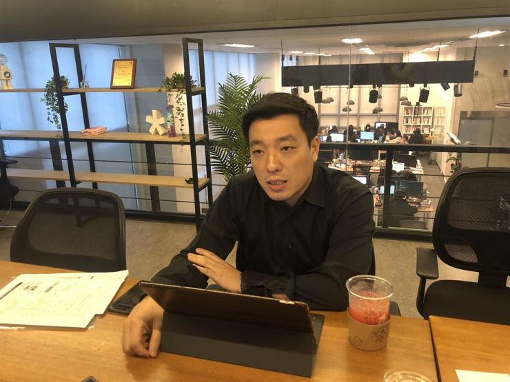 Simon Lee, CEO and founder of Flitto, speaks during an interview with The Korea Times at the firm's office in Seoul, Nov. 6. / Courtesy of Flitto