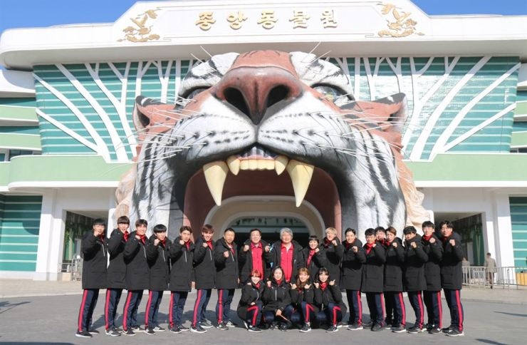 Members of the World Taekwondo demonstration team in front of the Pyongyang Zoo, Thursday. Courtesy of World Taekwondo