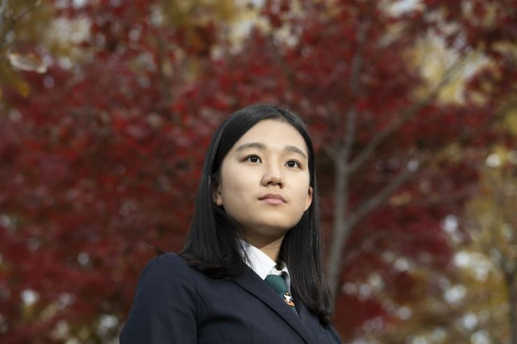 Choi Nyeong-ju, 16, stands outside the main building at Buyeong Girls' High School, a boarding school in Yeosu, South Jeolla Province, Nov. 13. / Korea Times photo by Choi Won-suk
