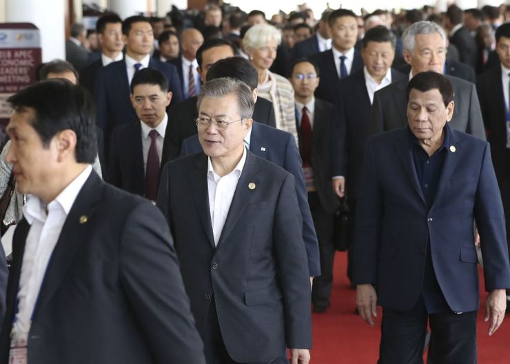 President Moon Jae-in is participating in this year's Asia-Pacific Economic Cooperation (APEC) Economic Leaders' Meeting in Papua New Guinea's capital of Port Moresby, Sunday. (KST), Yonhap