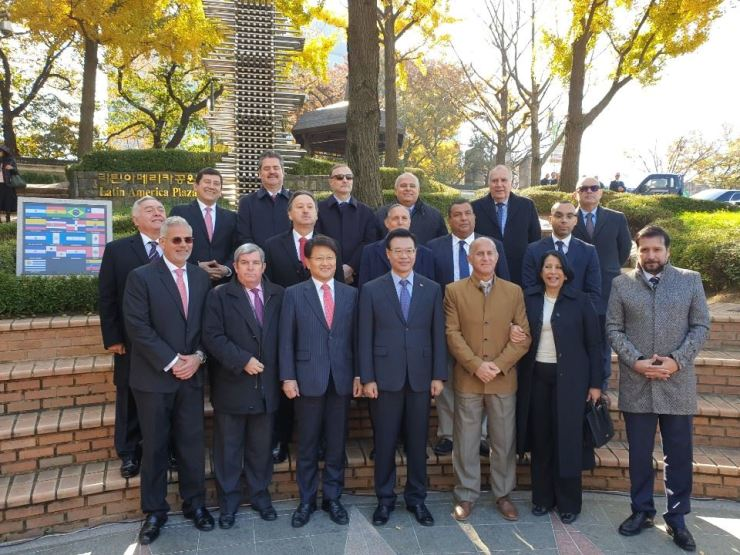 Ambassadors of Central and South American countries pose with Deputy Minister for Public Diplomacy Park Sang-hoon, third from left in the front row, and Yongsan-gu District Office chief Sung Jang-hyun, fourth from left in the front row, during a ceremony to celebrate the reopening of the Latin American Plaza in Yongsan-gu, Seoul, Nov. 1. / Korea Times photo by Yi Whan-woo