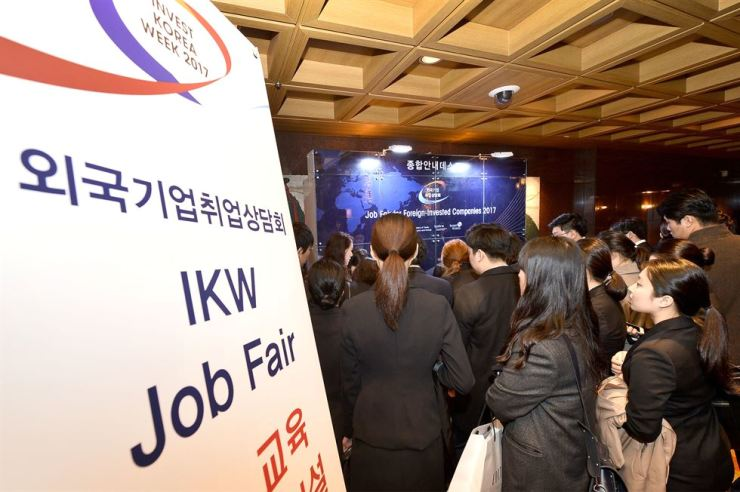 Jobseekers interested in foreign companies enter the Invest Korea Week job fair at Grand InterContinental Hotel Seoul Parnas in southern Seoul, during last year's event in this file photo. This year's fair will be held on Thursday. / Courtesy of Seoul Metropolitan Government