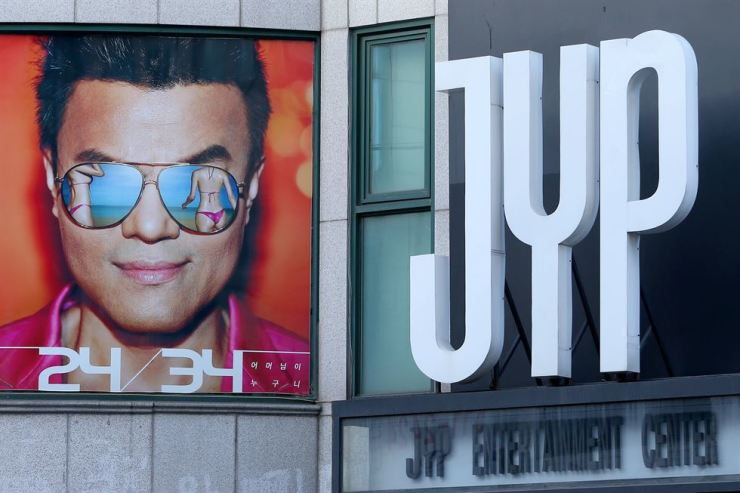JYP Entertainment CEO Park Jin-young on the promotional poster of his 2015 album '24/34' displayed over the company's previous office building in Gangnam-gu, Seoul. Park has revealed why his company abolished its intern system. Yonhap