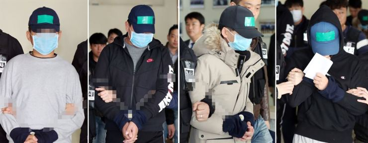 Four middle school students who allegedly lynched a peer to death on an apartment rooftop in Yeonsu-gu District in Incheon leave Incheon Namdong Police Station for questioning at Incheon District Court on Nov. 16. Yonhap