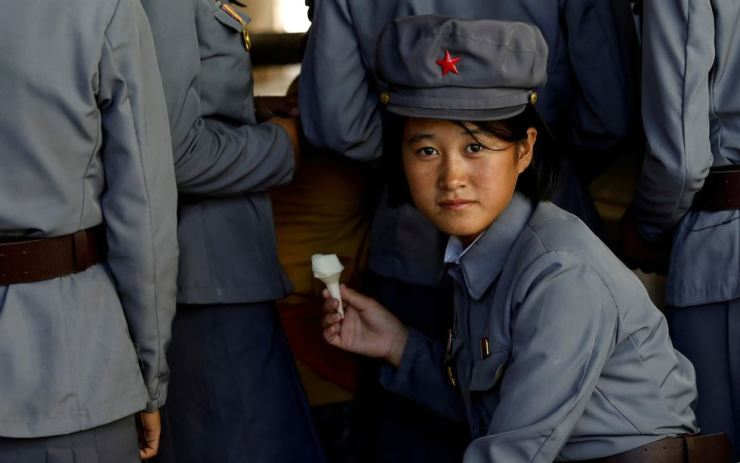 A soldier eats ice cream as she visits a zoo in Pyongyang, Sept. 12. Reuters
