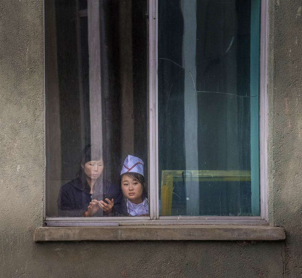 May | Four North Korean children take a peek at life outside their playpen in South Hamgyong Province. It is common for parents to send their children to daycare centers and nurseries and for households with working parents to send sick or malnourished children to local institutions until they recover. Courtesy of NK News