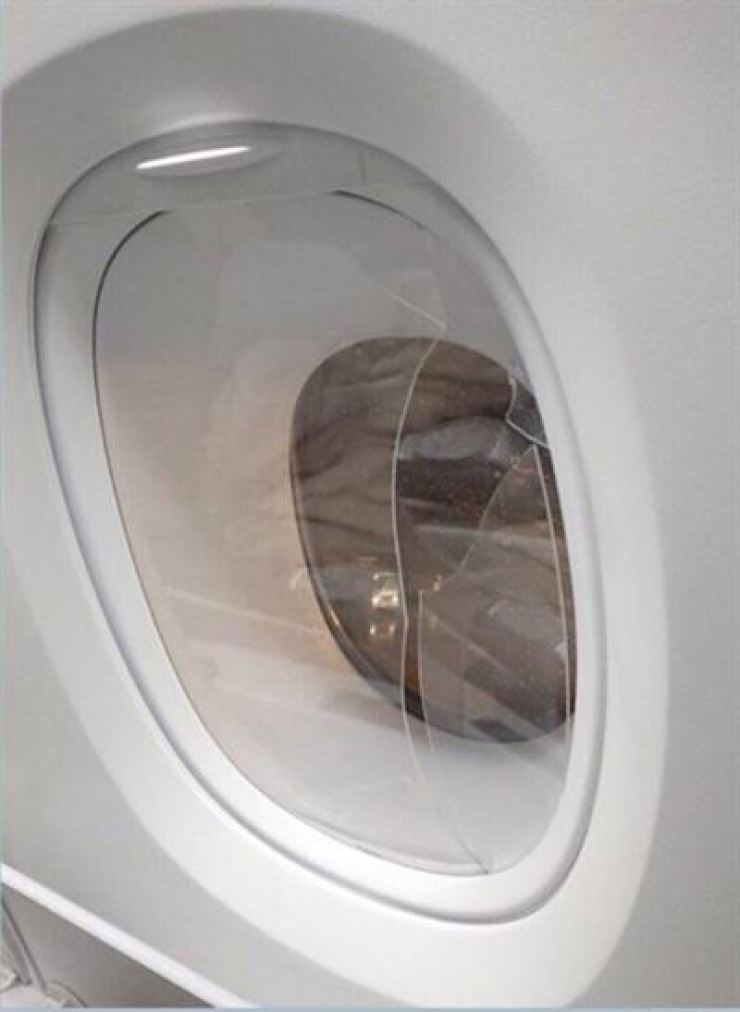 The man damaged the plane's inner plastic window during the flight. Yonhap
