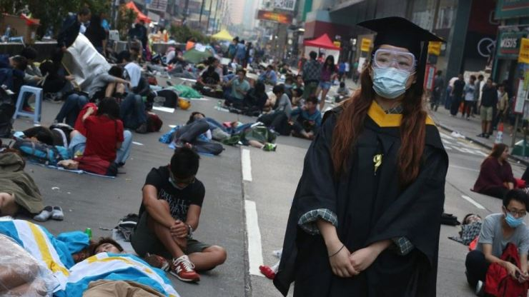 A protester wearing academic dress in Mong Kok during the Occupy movement protests in October 2014. Photos from the South China Morning Post