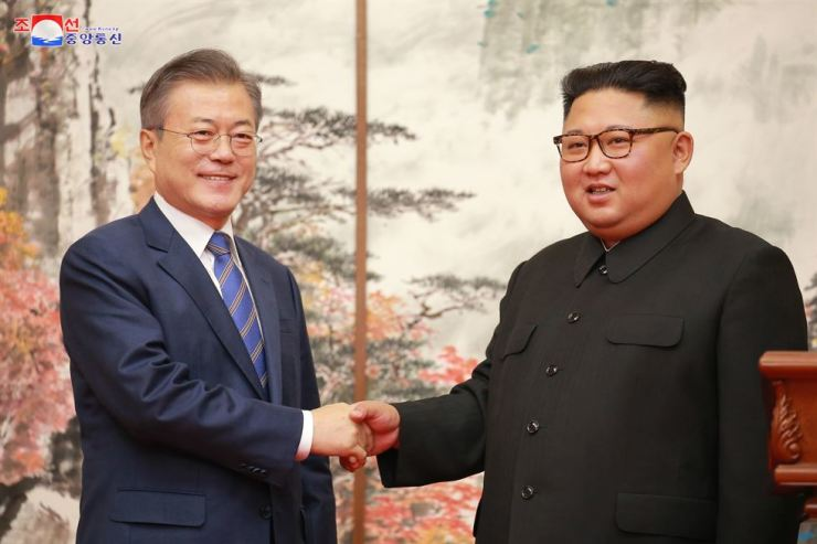 President Moon Jae-in and North Korean leader Kim Jong-un shake hands after signing an agreement at their third summit in Pyongyang in September. / Yonhap