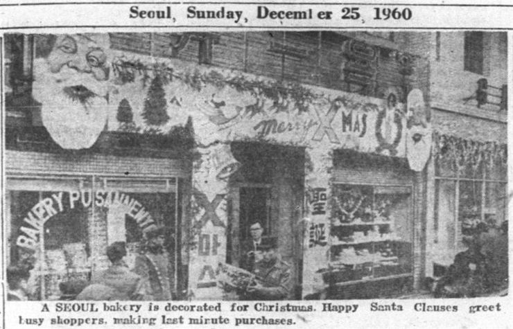 A bakery storefront in Myeong-dong is decorated for Christmas in 1960. / Korea Times archive