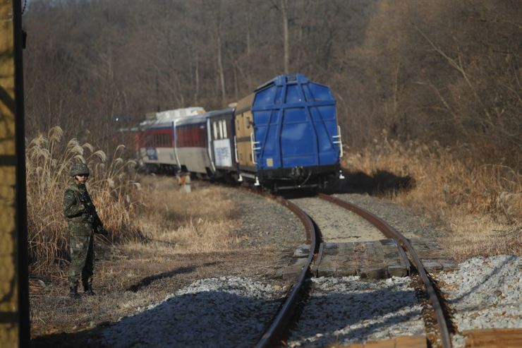 A South Korean train transporting dozens of South Korean officials runs on the rails leading to North Korea inside the Demilitarized Zone separating the two Koreas, in Paju, South Korea, on Nov. 30. AP-Yonhap