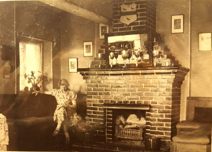 Mary Taylor sits near the fireplace in her house Dilkusha, possibly sometime around the mid-1920s. / Courtesy of Seoul History Museum