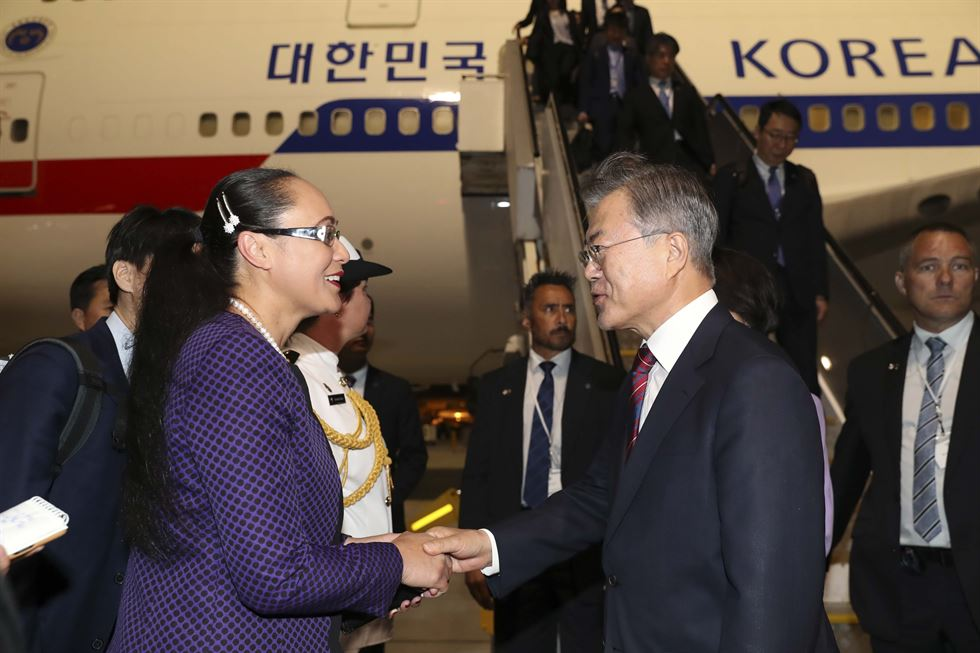 President Moon Jae-in speaks to reporters on the presidential flight en route to Auckland, New Zealand, for a three-day state visit, Sunday (KST). Yonhap