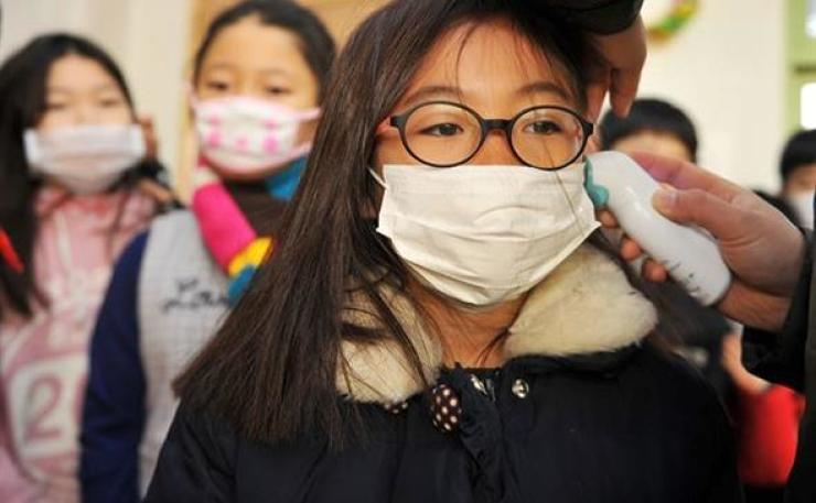 Suspected flu patients are on the rise. Hankook Ilbo file