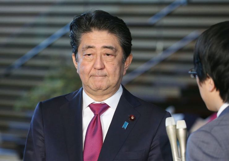 Japanese Prime Minister Shinzo Abe listens to questions from Japanese reporters at his residence on Oct. 30 after South Korea's Supreme Court ruled for Nippon Steel and Sumitomo Metal to compensate victims of forced labor during Japan's colonial rule. / Yonhap