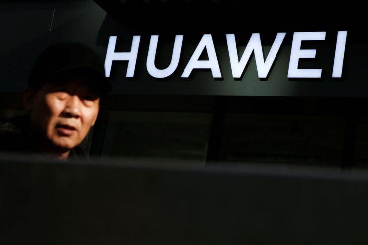A man walks past a Huawei phone retail shop in Beijing, China, Dec. 19. Reuters
