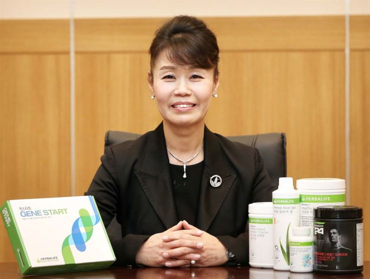 Herbalife Nutrition Korea General Manager Chung Young-hee promotes the company's Gene Start direct-to-consumer genetic testing service at her office in Seoul in this file photo. / Courtesy of Herbalife Nutrition Korea