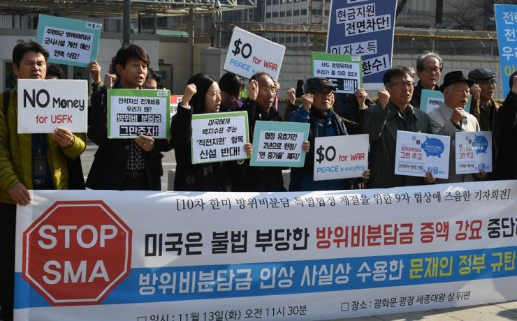 A civic group protests at Gwanghwamun Square in central Seoul, Nov. 13, against Washington's call for South Korea to pay more for the stationing of U.S. troops here. / Korea Times file