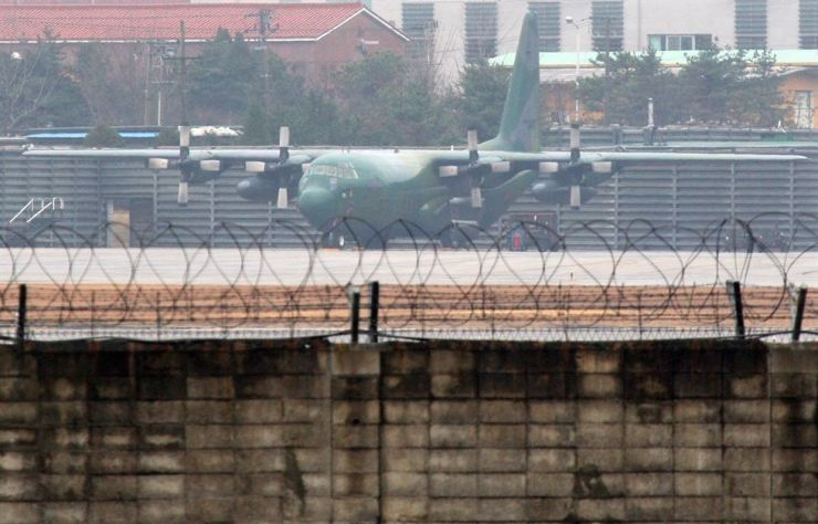 A drunk Thai man apparently climbed triple-layered barbed wire security fence of a Republic of Korea Air Force airfield in Suwon. Yonhap