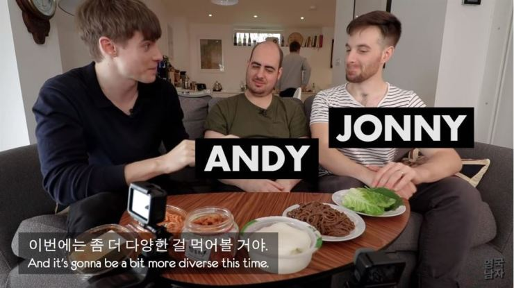 In this video uploaded Wednesday to the popular YouTube account Korean Englishman, YouTuber Josh, left, introduces Korean Mak-guksu (a Korean buckwheat noodle dish) to his British friends. Captured from the Korean Englishman's YouTube channel