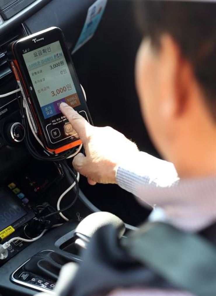 The base fare for taxis will increase to 3,800 won starting next year. / Yonhap